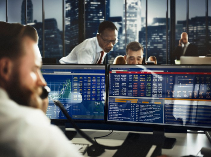 Stock brokers at computer terminals