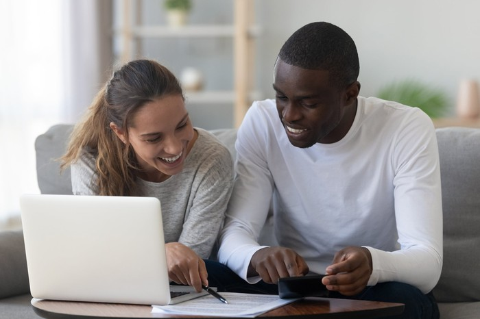 A couple reviewing a document at home.