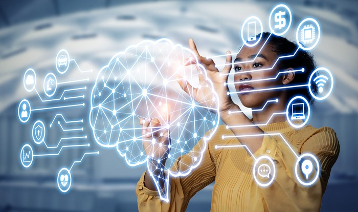 Woman interacting with a digital cortex, suggesting artificial intelligence.