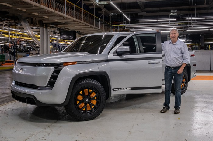 Former CEO Steve Burns standing next to a prototype of the Endurance pickup.
