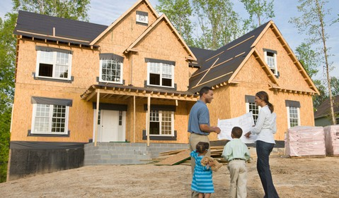 family in front of house construction getty 1