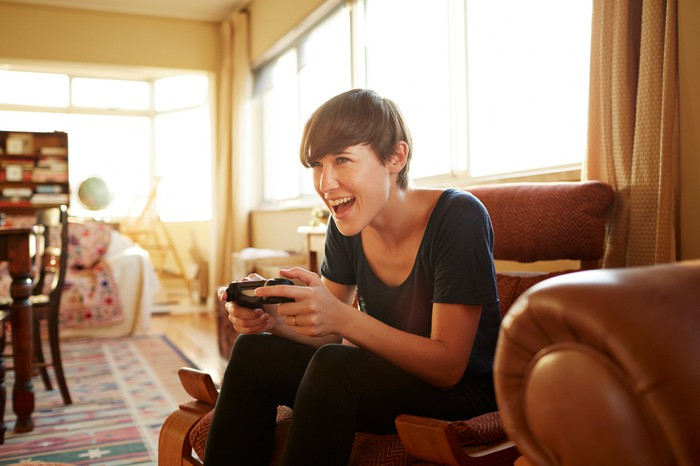 A person plays a video game at home.