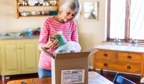 person opening box with online purchase