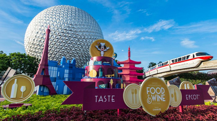 The front of Epcot featuring the iconic World Showcase globe and a monorail circling the park during a festival.