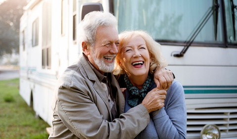 21_09_15 Two people hugging in front of a recreational vehicle _GettyImages-1183829756