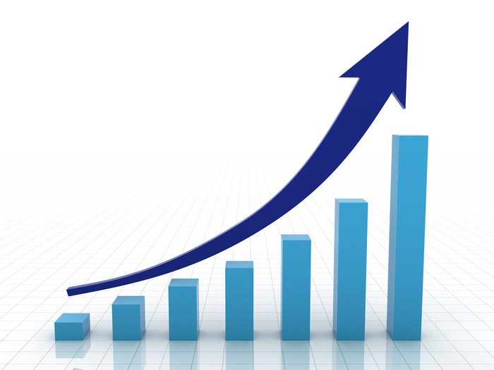 Rising blue bar chart with arrowed trend line.