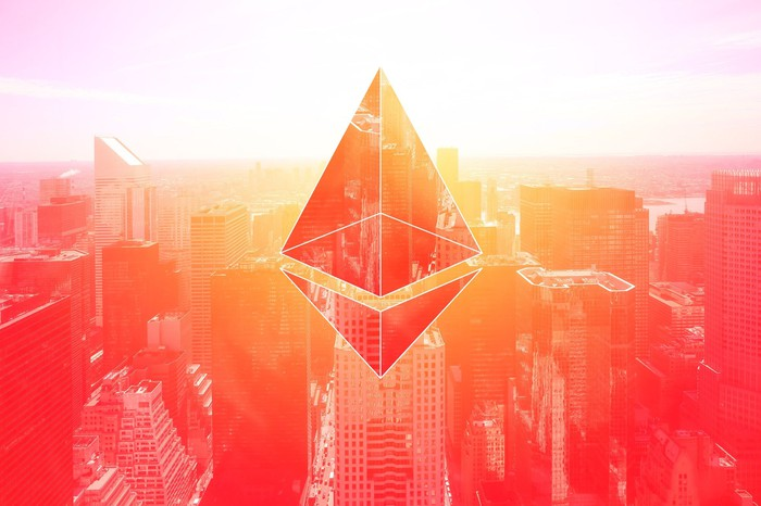 Ethereum logo in front of a cityscape.