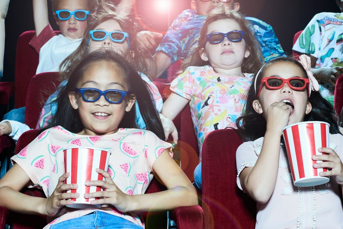 A group of children in a theater.