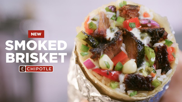 A tin-foil wrapped burrito with smoked brisket as the protein.