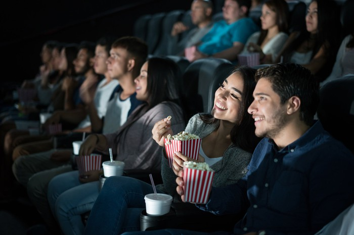 A group of people in a movie theater.