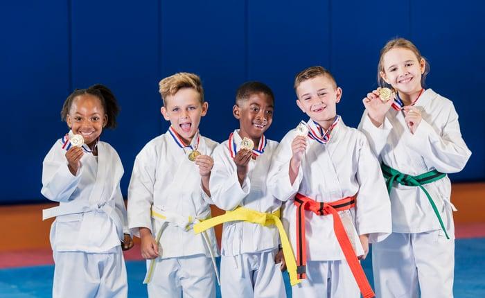 5 children showing off their medals.