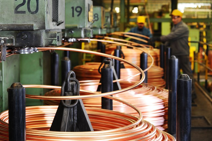 Rolls of coiled copper tubing in an industrial factory.