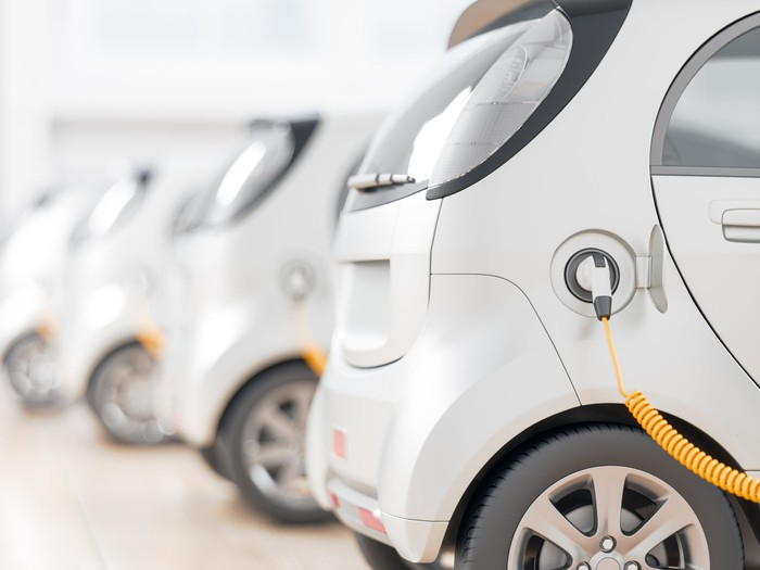 Fleet of electric vehicles being charged.