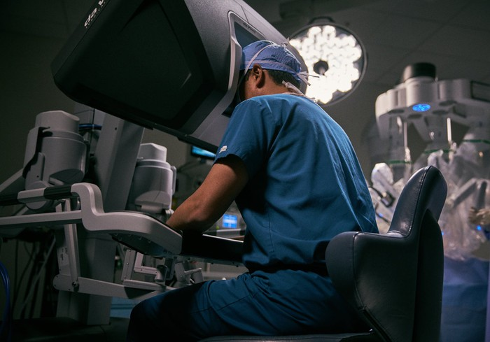 A surgeon at the control console of one of Intuitive's robotic-surgery products.