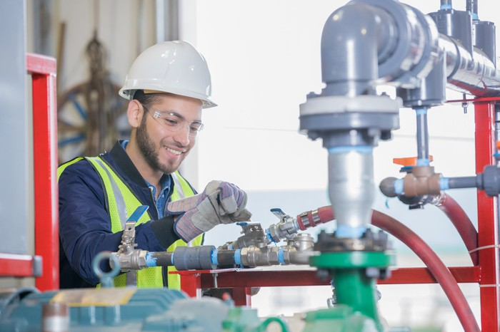 An engineer working on pipeline equipment.