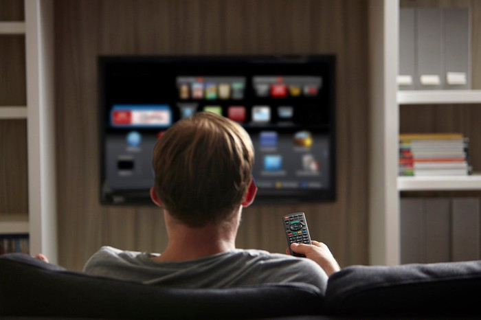 A person is watching content on a smart TV.