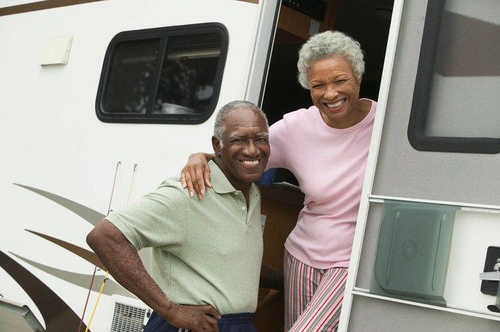 Two people in the doorway of a recreational vehicle.
