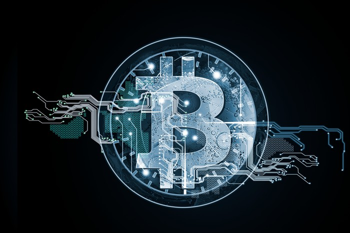 A grey Bitcoin logo in the background.