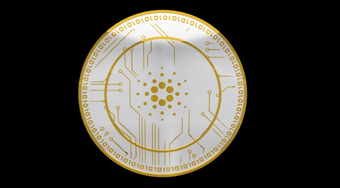 A golden ADA coin with binary digits inscribed on its outer ring.