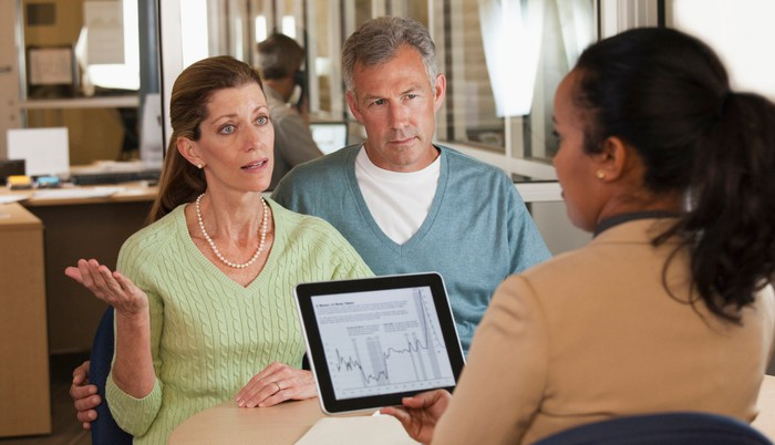 Couple talking with a financial advisor