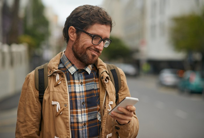 A person looking confusingly at his phone.