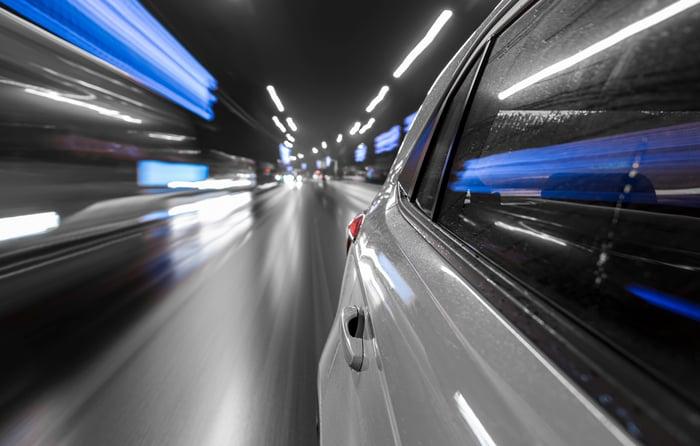 Car speeding on road