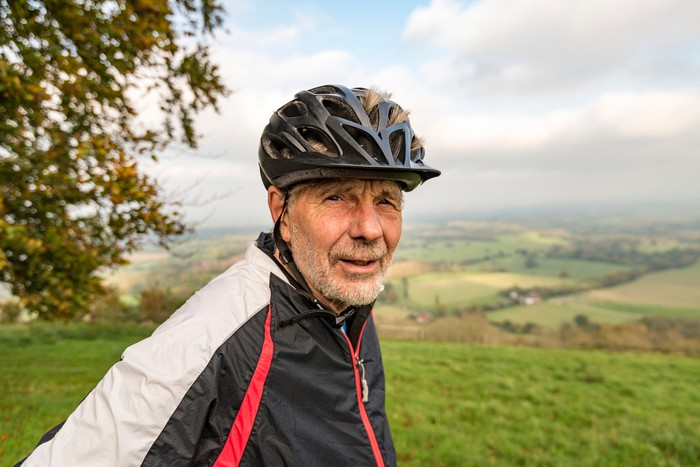 Person outdoors wearing bike helmet.