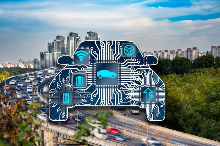 Stylized car full of semiconductor chips against a backdrop of a busy city freeway.