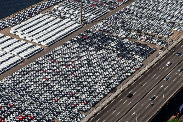 An aerial view of cars and trucks parked after manufacture, awaiting shipment.