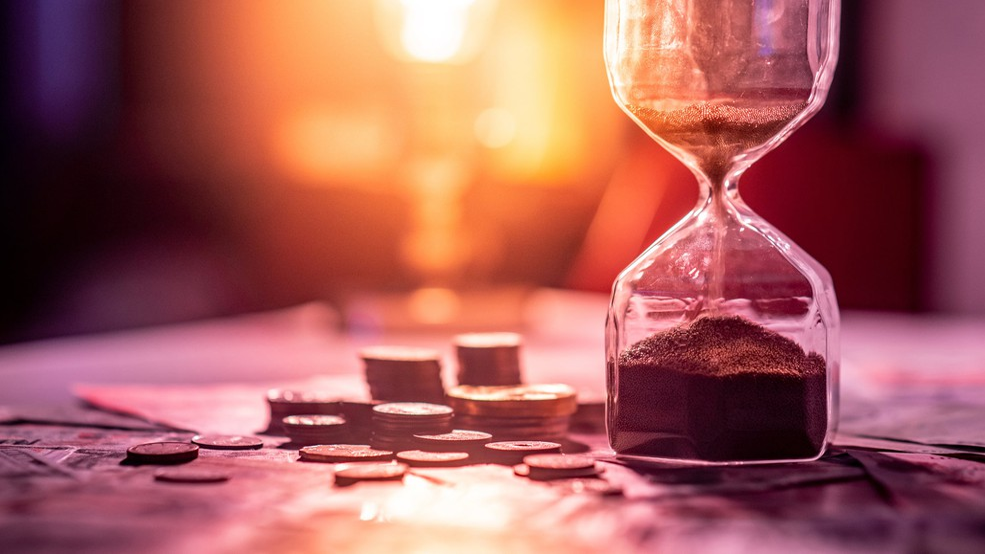 Hourglass Coins Cash Bills Money Invest Rich Retirement Compound Getty