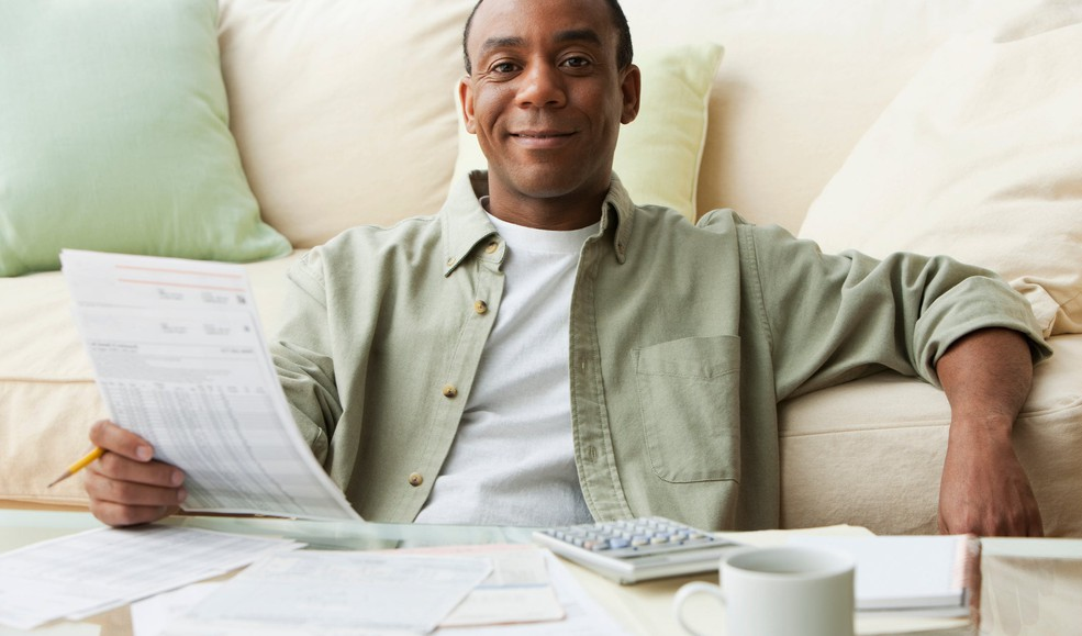 A person smiling and reviewing their finances.