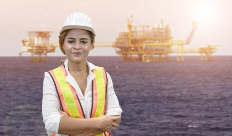 20_11_24 A person with offshore oil rigs in the background _GettyImages-1215049822