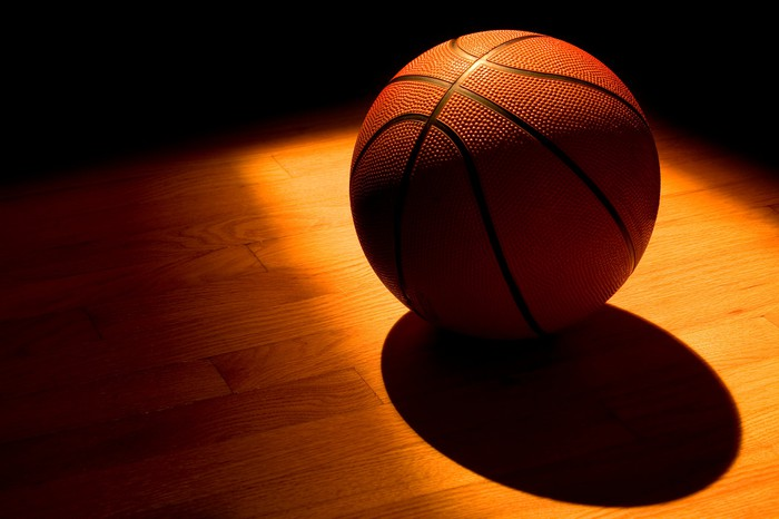 A basketball in a ray of sunlight