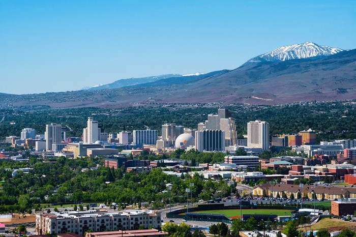 An aerial view of Reno, Nevada, with mountains in the background.