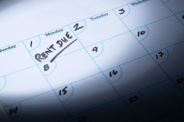 """A calendar with """"rent due"""" written on the first of the month"""
