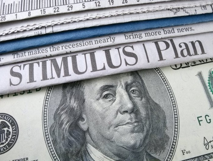 Newspaper headlines about a stimulus plan and a $100 bill.