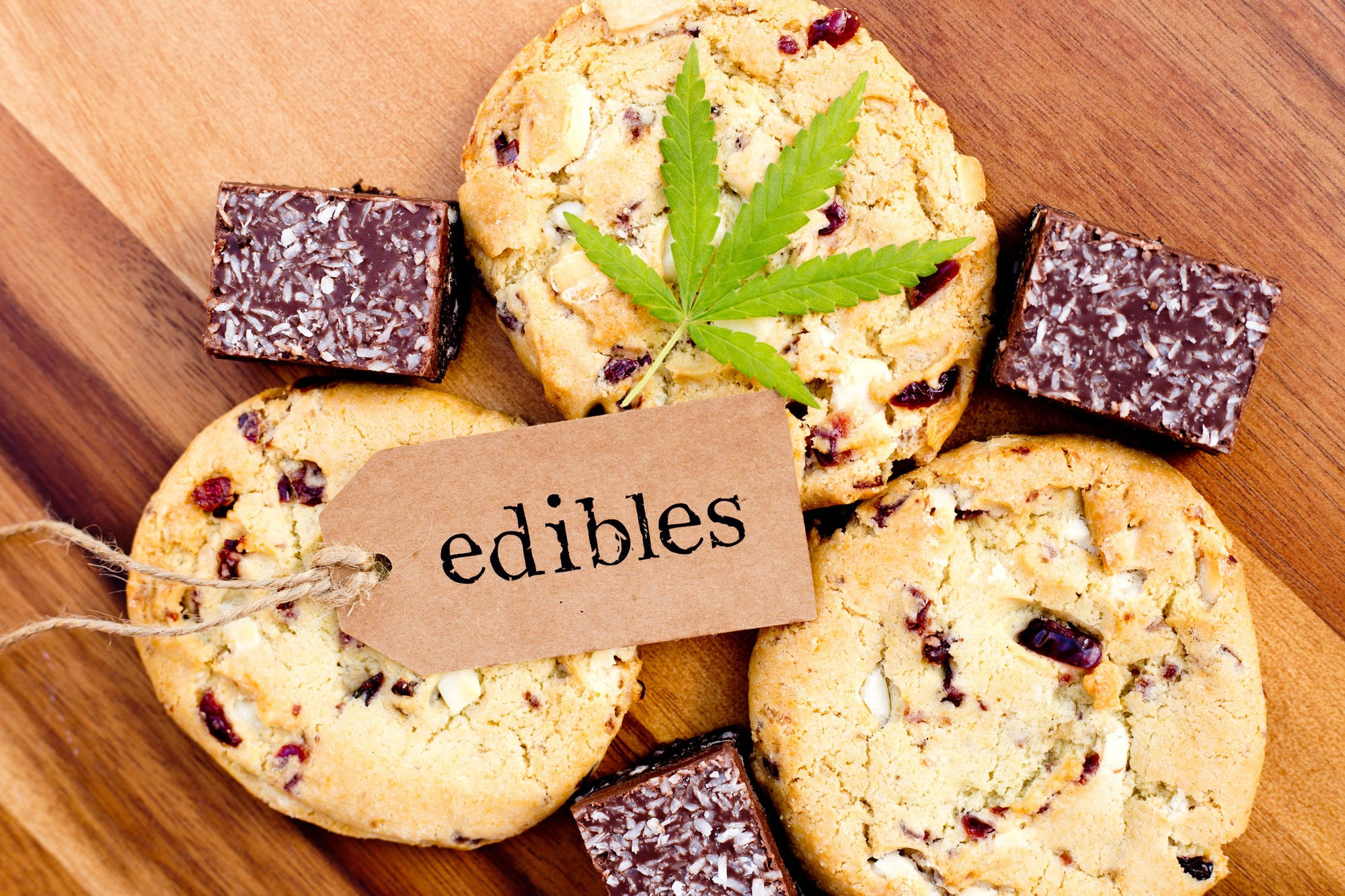 "Cannabis edible cookies and brownies, with a marijuana leaf and a tag with ""edibles"" on it."