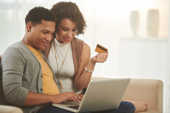 Couple making an online credit card purchase